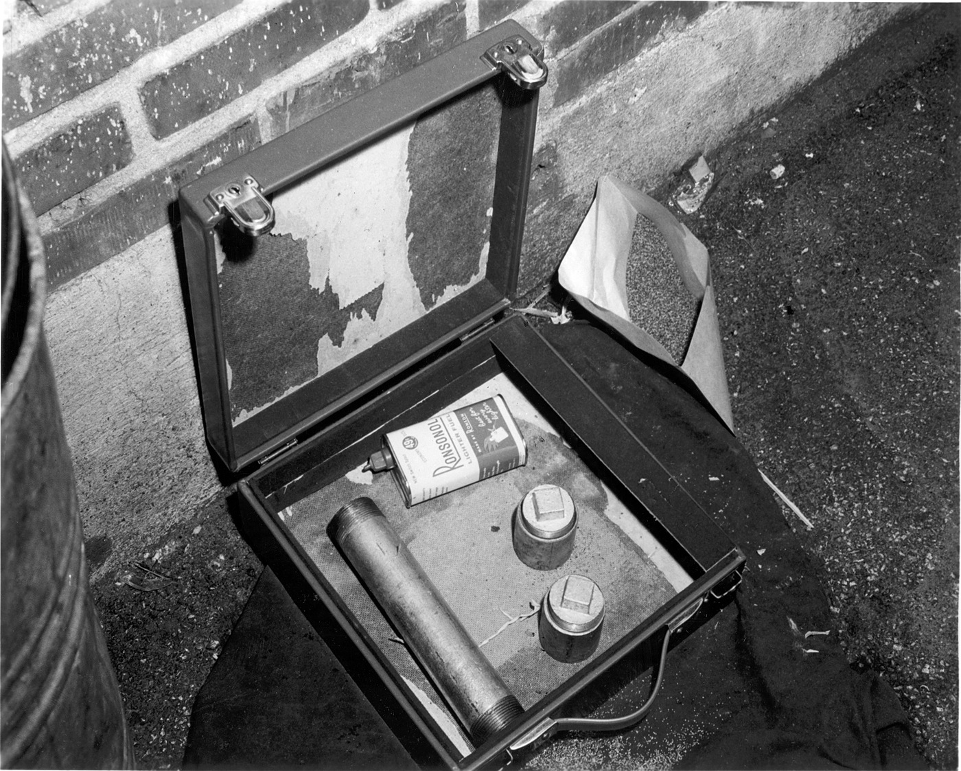 Undetonated homemade bomb made by Albert Nussbaum in 1961 to distract law enforcement in Washington, D.C., while he and Bobby Wilcoxson robbed a bank and that revealed the fingerprints of Nussbaum.