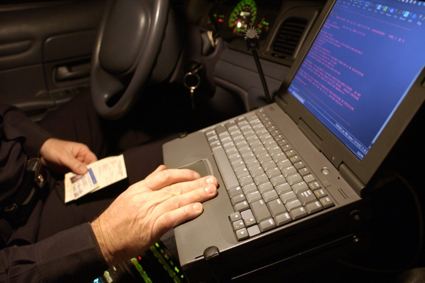 Officer Using Computer in Car (Stock)