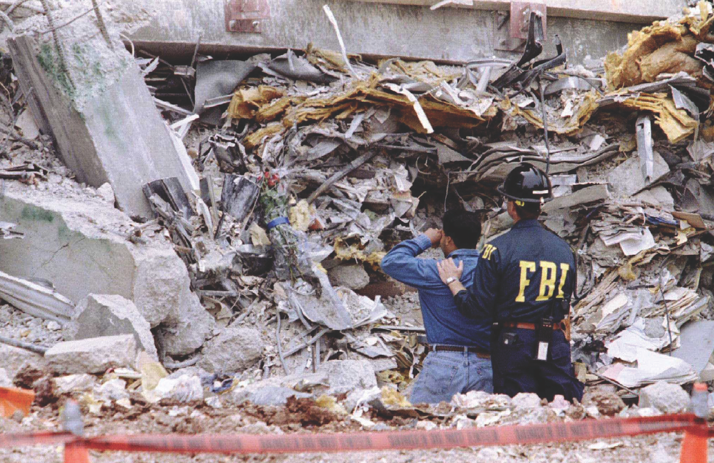 An FBI agent comforts a man who lost a loved one in the April 1995 Oklahoma City Bombing. Rueters photo.