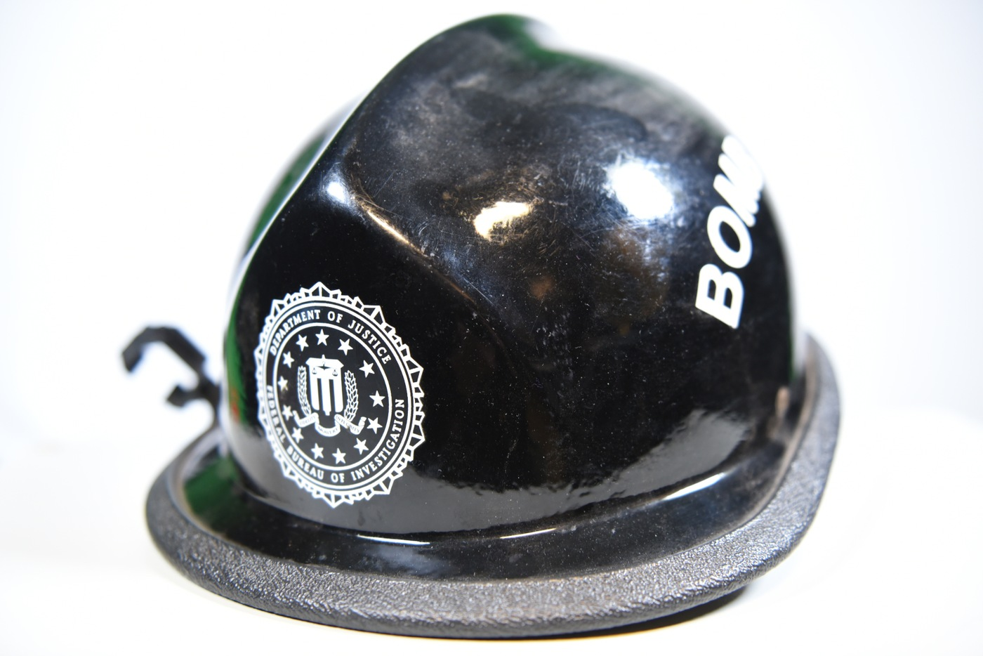 The protective hard hat worn by FBI Oklahoma City Special Agent Barry Black during the recovery and investigation of the Oklahoma City bombing.