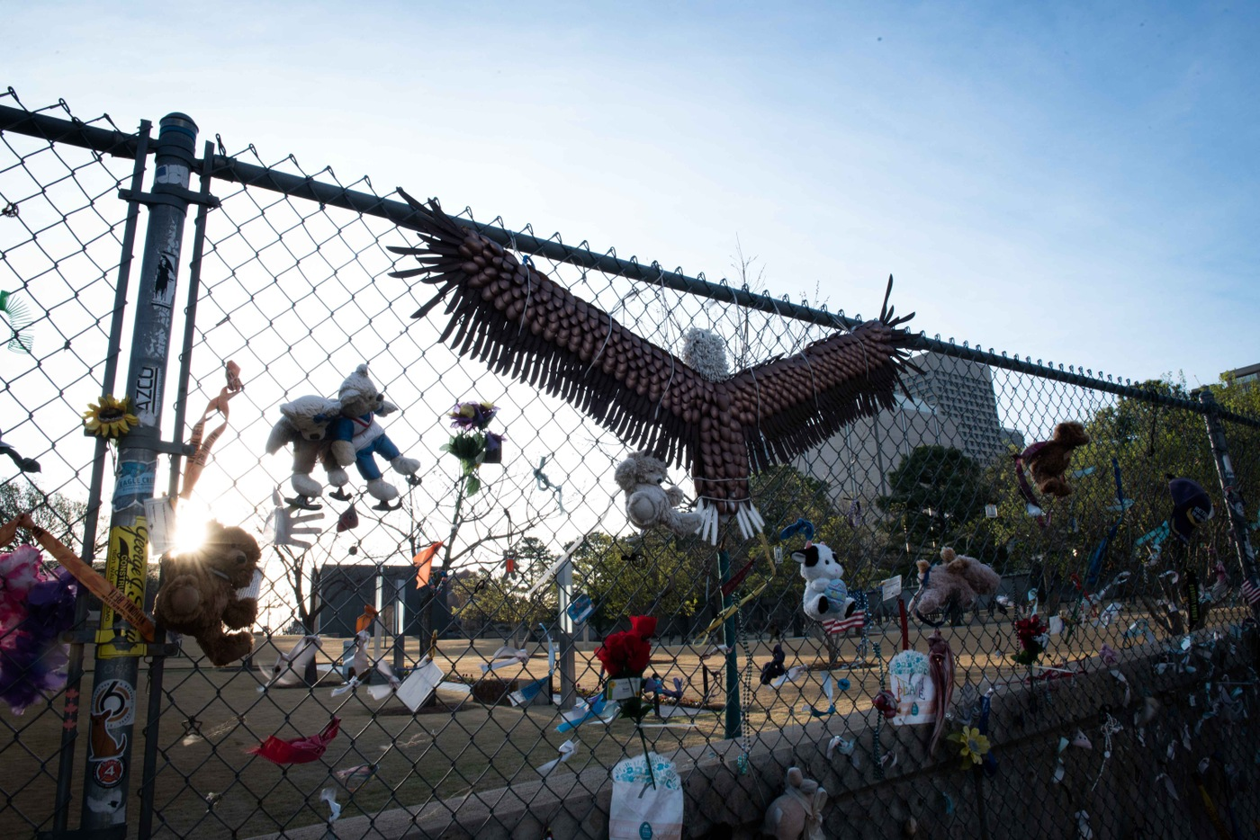 A fence next to the Oklahoma City National Memorial and Museum serves as a place for visitors to pay their respects and leave mementos.