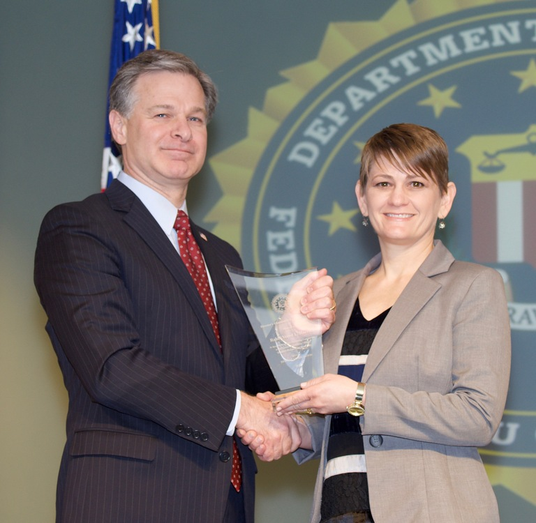 FBI Director Christopher Wray presents Oklahoma City Division recipient Rabbi Vered Harris with the Director's Community Leadership Award (DCLA) at a ceremony at FBI Headquarters on April 20, 2018.