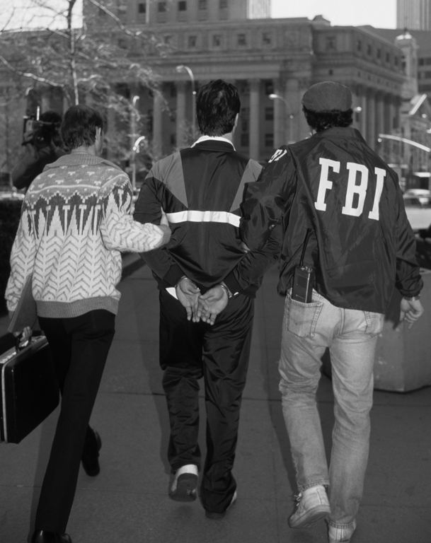 FBI agents arrest a member of the New York Mafia in March 1988. Robert Maass/CORBIS.