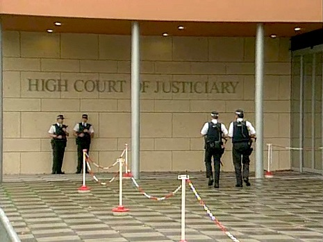 Scottish police stand outside the High Court of Justiciary in the Netherlands during the trial of two suspects in the December 21, 1988 bombing of Pan Am Flight 103 over Lockerbie, Scotland. (ITN/Getty Images)