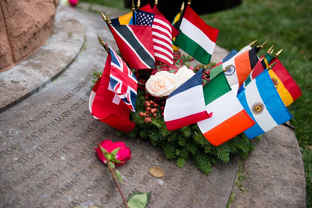 Wreath, flags, and flowers on the base of the Pan Am Flight 103 memorial cairn at Arlington National Cemetery following a December 21, 2015 memorial anniversary ceremony honoring the 270 victims of the 1988 bombing over Lockerbie, Scotland. (U.S. Army photo by Rachel Larue/Arlington National Cemetery/released)
