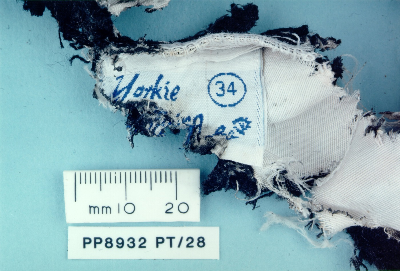 Evidence collected following the December 21, 1988 bombing of Pan Am Fight 103 over Lockerbie, Scotland, included this piece of fabric from a clothing store in Malta. (Syracuse University photo)