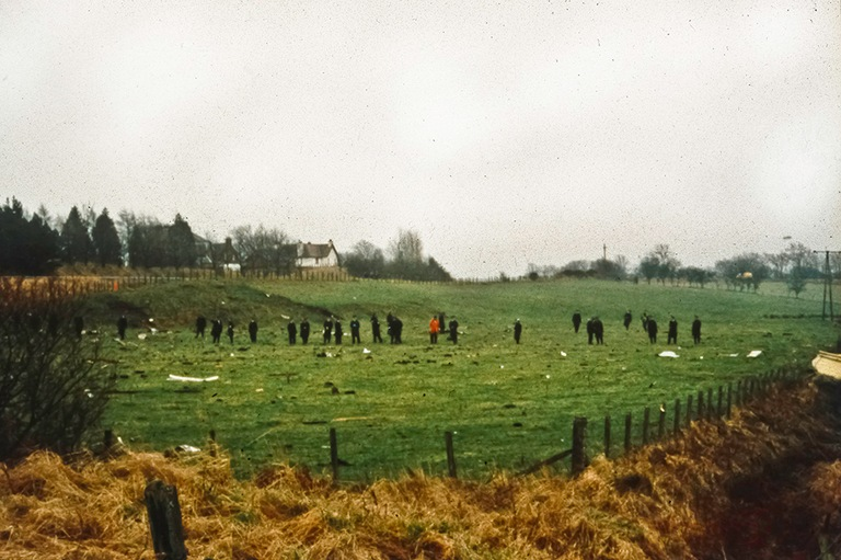 Scottish police officers search for debris and evidence in fields after the December 21, 1988 bombing of Pan Am Flight 103 over Lockerbie, Scotland. (Syracuse University photo)