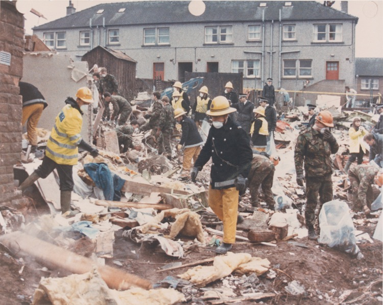 Responders search the neighborhood of Rosebank, in the center of Lockerbie, Scotland, following the December 21, 1988 bombing of Pan Am Flight 103. (Syracuse University photo)