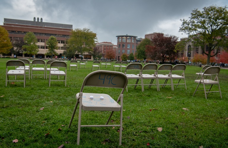 Chairs arranged on the campus of Syracuse University during Remembrance Week in 2018; the pattern of chairs represents where the 35 Syracuse students who were killed in the December 21, 1988 bombing of Pan Am Flight 103 over Lockerbie, Scotland, were seated.