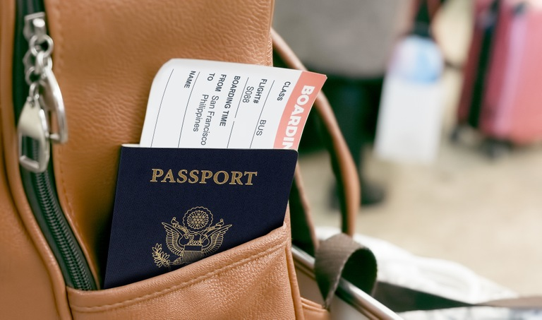Passport and Boarding Pass in Bag (Stock Image)