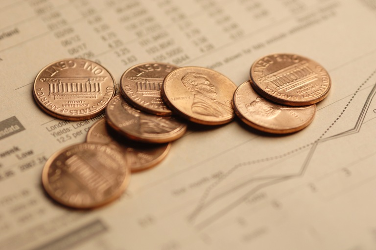 Pennies on Stock Price Documents (Stock Image)