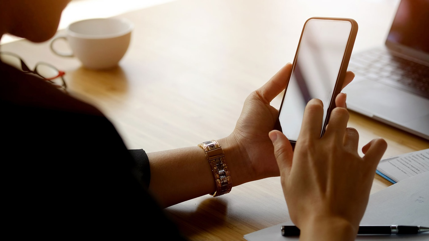 Stock image of person holding smartphone.