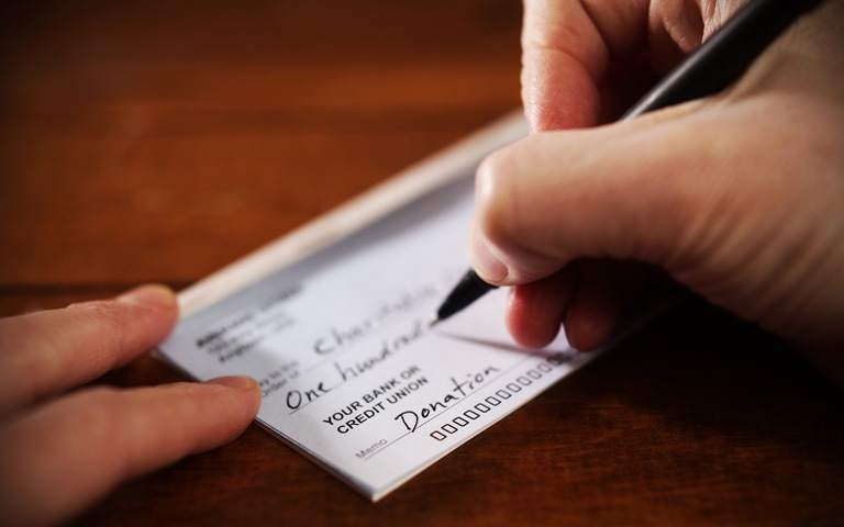 Person Writing Check (Stock Image)
