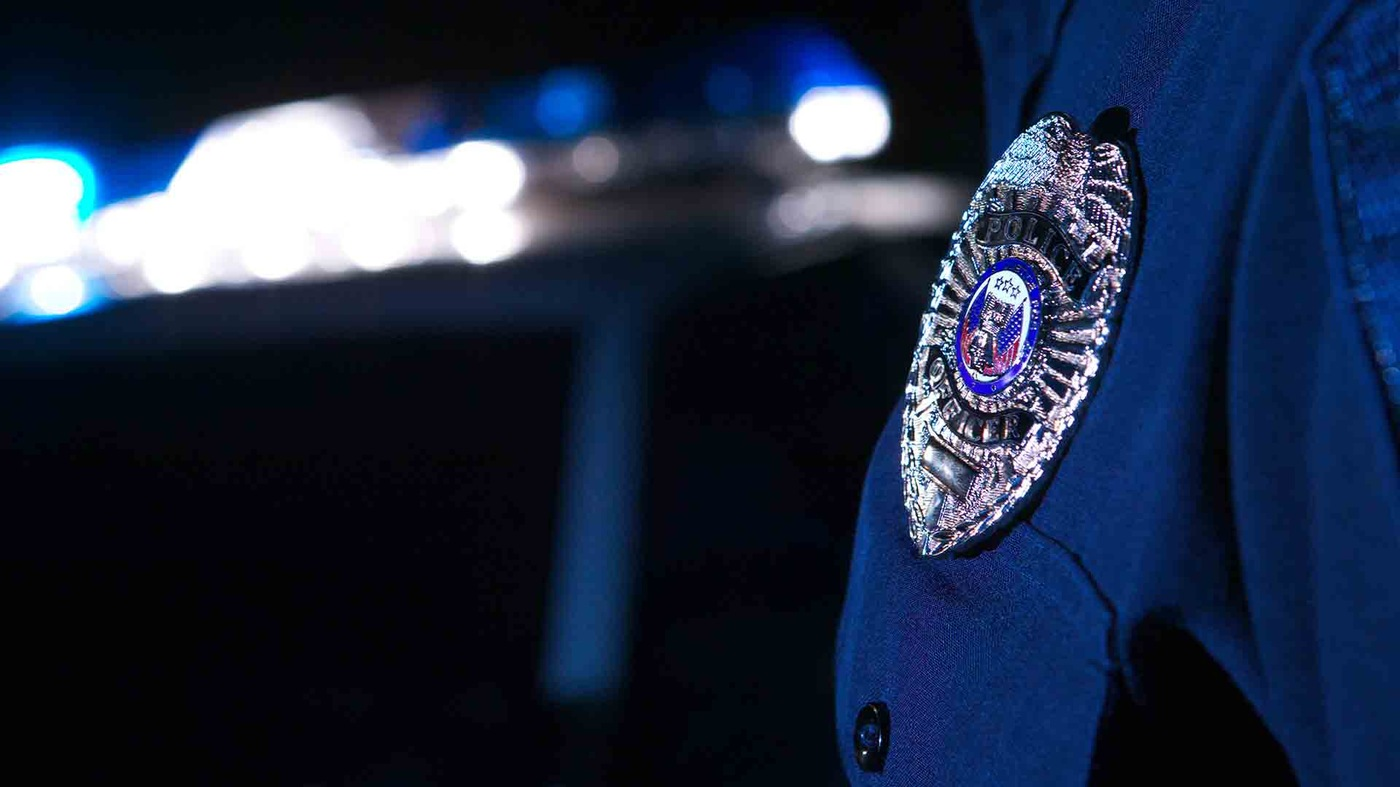 Stock image depicting police badge/patch on officer's sleeve.