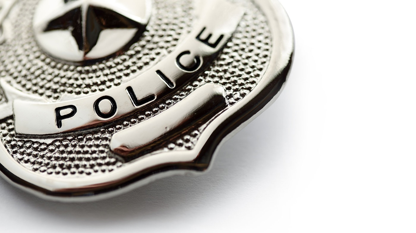 Stock image depicting a police badge.