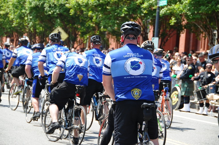 Participants in the Police Unity Tour arrive by bicycle at the National Law Enforcement Memorial in Washington, D.C., on May 12, 2018.