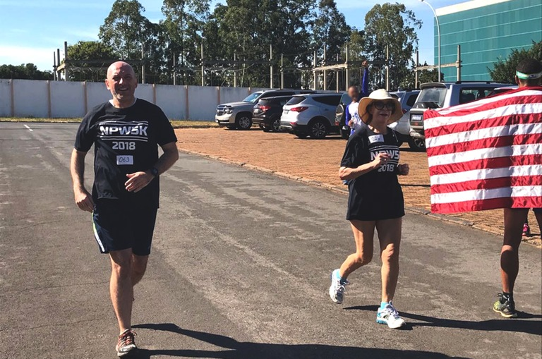 In solidarity with the annual Police Week 5K held in Washington, D.C., FBI Brasilia Legat David Brassanini ran a 5K with colleague Marilia de Araujo in Brasilia in memory of Special Agent Melissa Morrow, who died earlier this year as a direct result of her work at the Pentagon after 9/11.