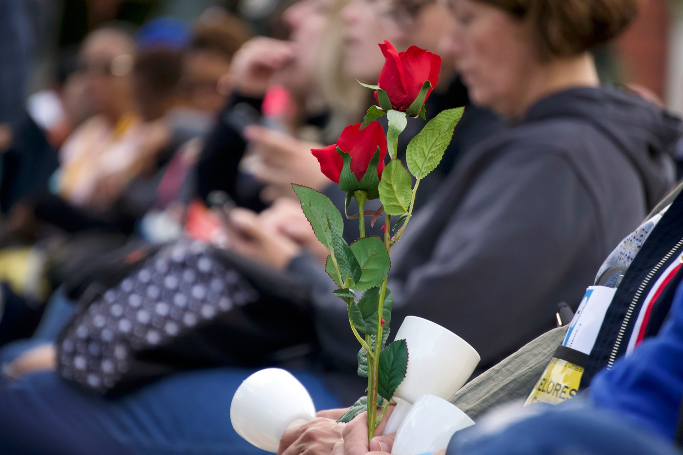Flowers are held during a May 13, 2019 candlelight vigil honoring fallen officers on the National Mall in Washington, D.C., during National Police Week.