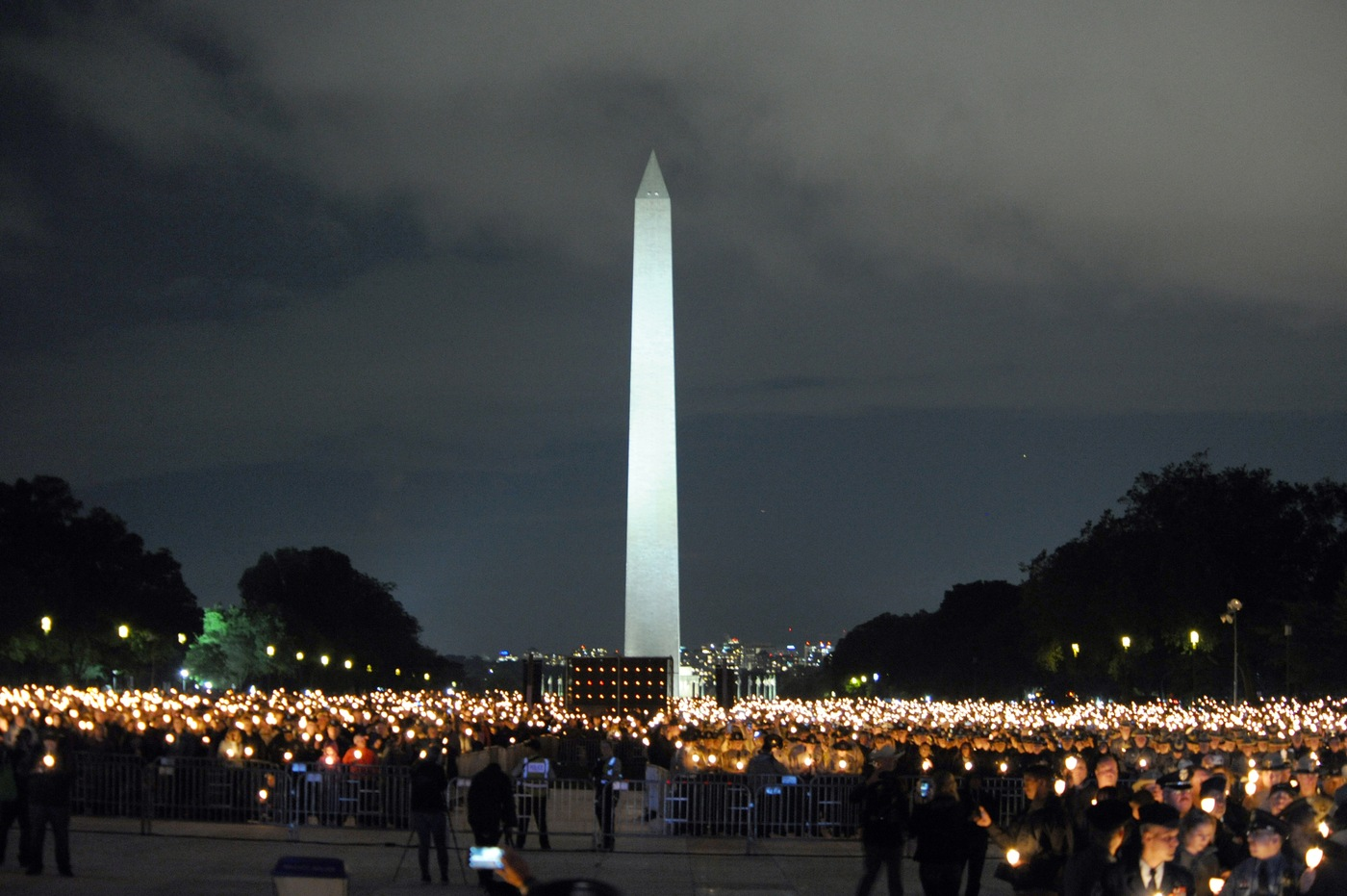 The Washington Monument serves as a backdrop for an estimated 30,000 people who attended a May 13, 2019 candlelight vigil honoring fallen officers on the National Mall in Washington, D.C., during National Police Week.