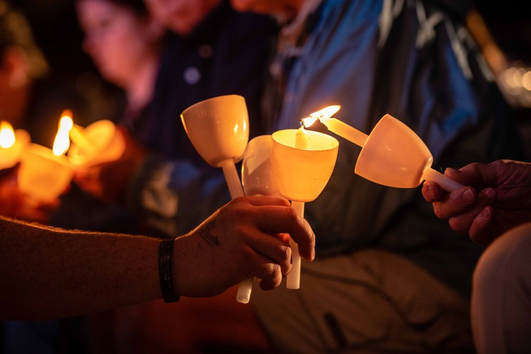The flame is passed during a vigil for fallen officers on May 13, 2018 in Washington, D.C. The candlelight vigil on the National Mall is the signature event of National Police Week observations.
