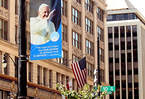 A banner in Washington, D.C. welcomes Pope Francis. The FBI is part of the highly orchestrated security effort surrounding the pope's six-day visit to D.C., New York City, and Philadelphia.