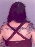 Photo of tattoo on wanted fugitive Josephine Sunshine Overaker's back. The tattoo is an image of a bird that runs from her upper right arm across her upper back. On January 19, 2006, a federal grand jury in Eugene, Oregon indicted Josephine Sunshine Overaker on multiple charges related to her alleged role in a domestic terrorism cell, part of the FBI's Operation Backfire investigation.