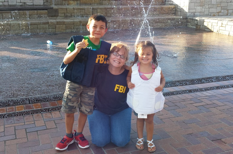 FBI Portland employee with children wearing FBI gear at a National Night Out event on August 5, 2014.