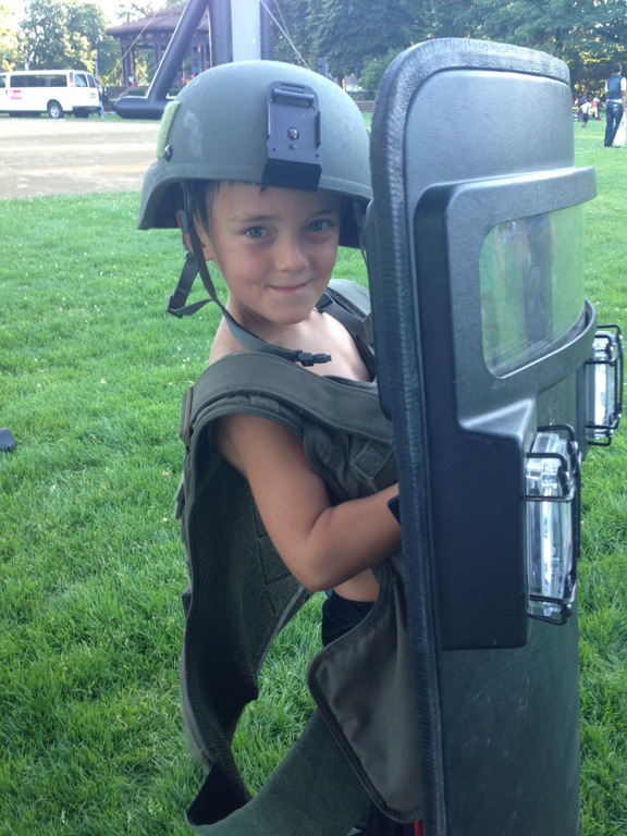 A child wears FBI gear at a National Night Out event on August 5, 2014 attended by FBI Portland.
