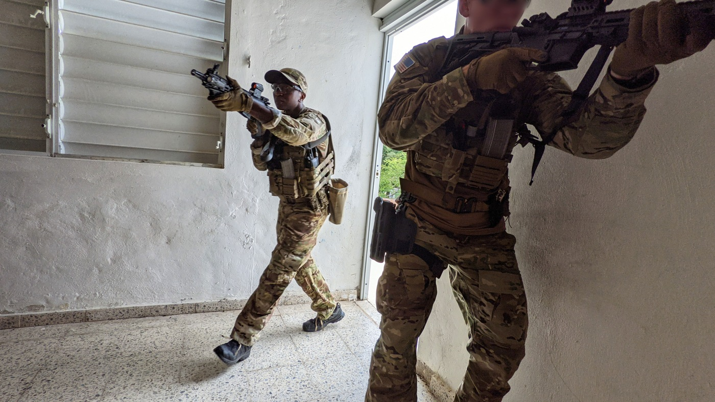 SWAT selectee Tai enters a room during close-quarters battle training during SWAT New Operator Training School, or NOTS, in San Juan, Puerto Rico in May 2021.