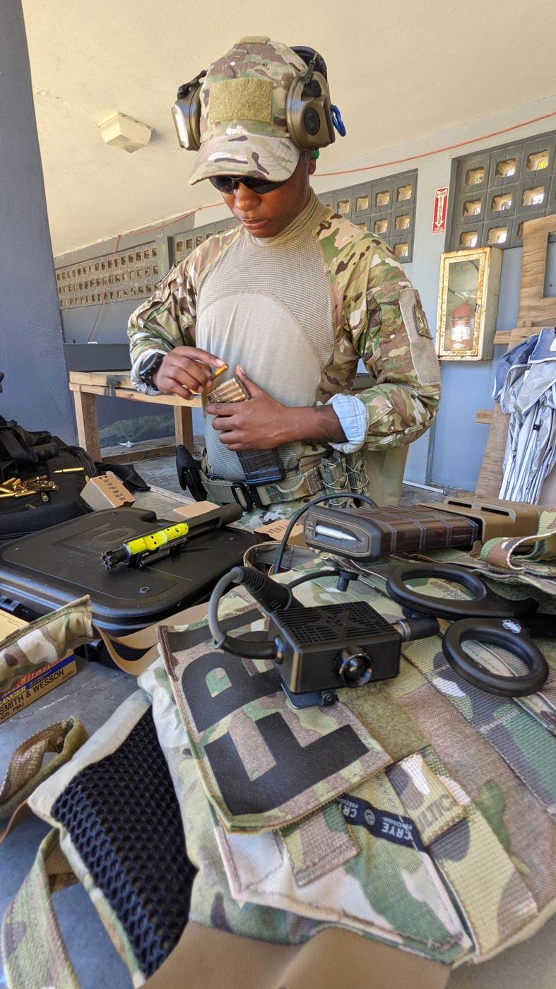 SWAT selectee Tai tends to her equipment during SWAT New Operator Training School, or NOTS, in San Juan, Puerto Rico in May 2021.