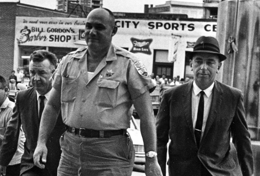 Neshoba County Sheriff Lawrence Rainey, flanked by FBI agents, is brought to court in October 1964 in connection with the Mississippi Burning murders. AP Photo.
