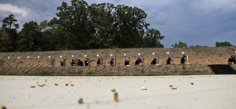 New agent trainees score their targets in 2010, leaving behind their spent shell casings (in the foreground).