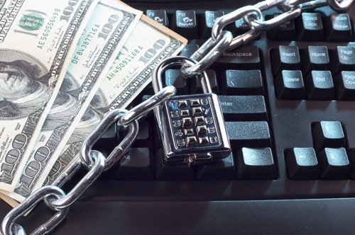 Image showing computer keyboard, money, padlock, and chain. Stock photo.
