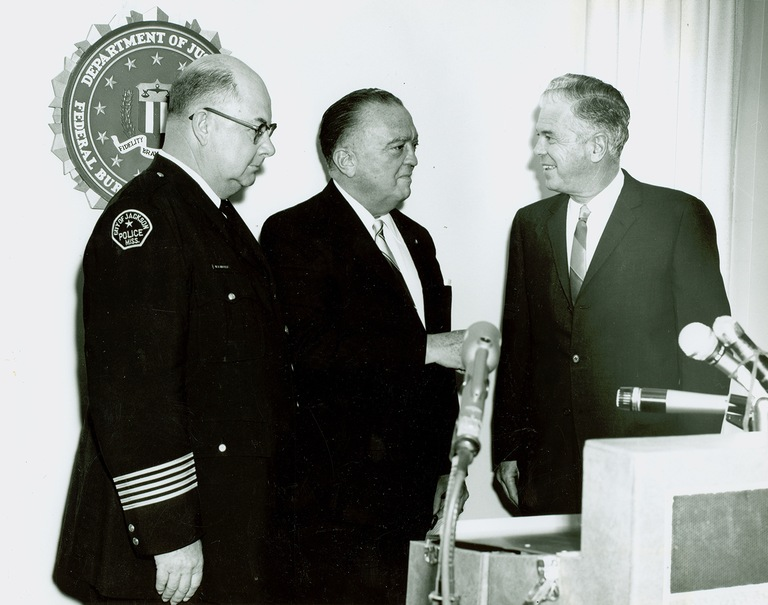 Director Hoover greets Jackson Police Department Chief W.D. Rayfield (left) and Jackson Mayor Allen C. Thompson (right) in the newly opened Jackson FBI Field Office on July 10, 1964.