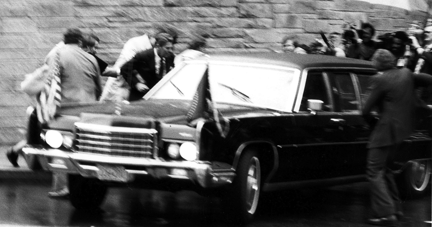 President Ronald Reagan right after being shot by John Hinckley on March 30, 1981. Following the attack, the FBI launched a massive investigation to determine Hinckley's motives and whether or not others were involved in the assassination attempt. Tracing Hinckley's life and movements across the country, the FBI concluded that he had acted on his own.