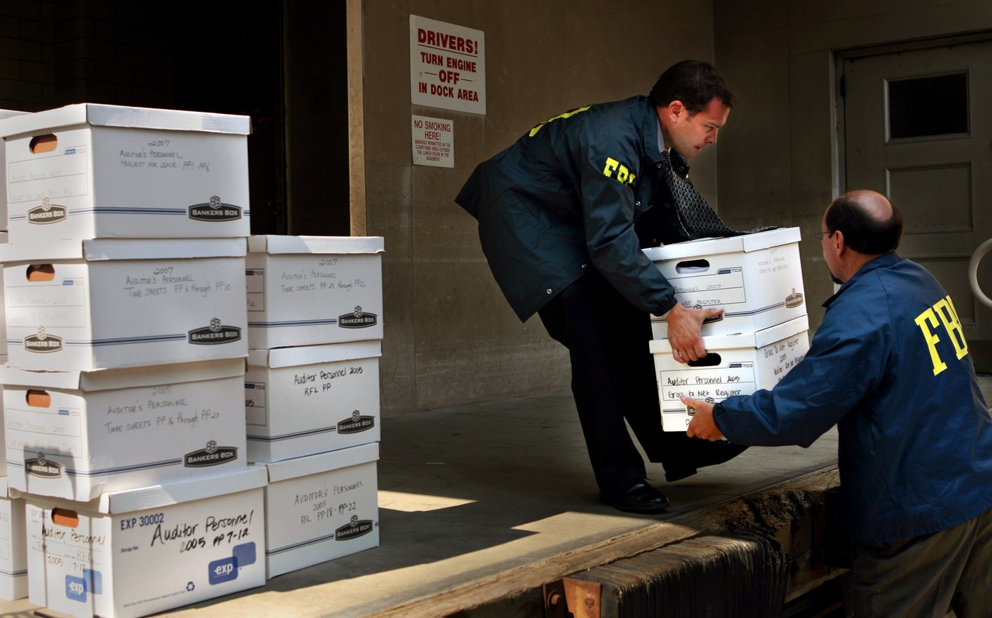 FBI agents load boxes confiscated from offices in the Cuyahoga County Administration Building into a truck. The FBI and IRS raided the building and other locations in the Cleveland area as part of a corruption probe.