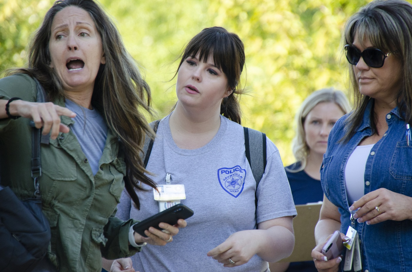 Jennifer Winchester (second from left), a victim advocate in the Kaysville Police Department in Utah, and Kim Messina, victim services manager for the Brighton Police Department in Colorado, meet a distraught family member (role-player) near a crime scene during a September 25, 2019, mass-casualty exercise at the FBI Training Academy in Quantico, Virginia. The exercise culminated ELEVATE-APB training for victim service providers.