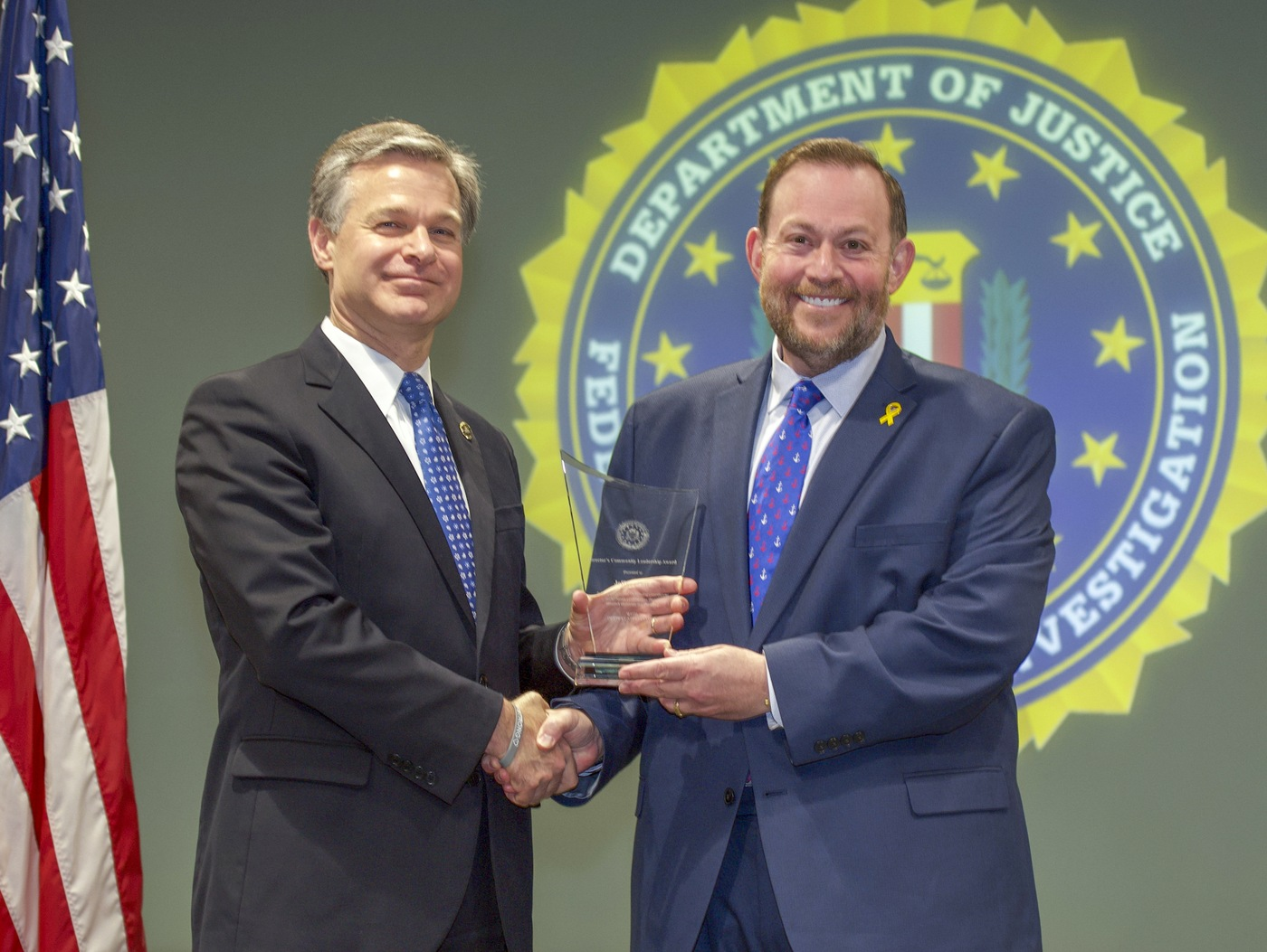 FBI Director Christopher Wray presents Richmond Division recipient Jeffrey Katz with the Director's Community Leadership Award (DCLA) at a ceremony at FBI Headquarters on May 3, 2019.
