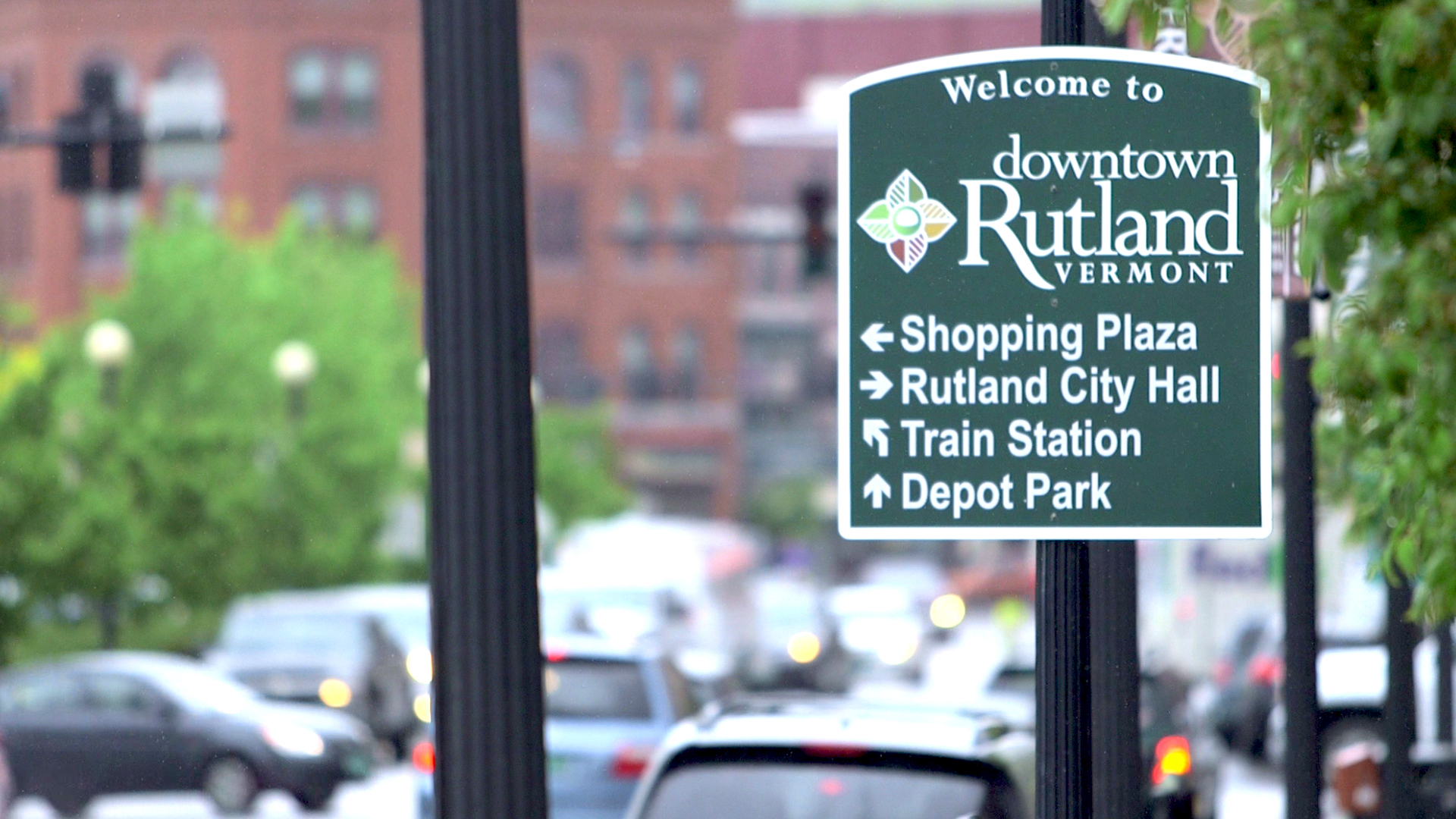 A locator sign in downtown Rutland, Vermont directing people toward the shopping plaza, city hall, train station, and Depot Park.