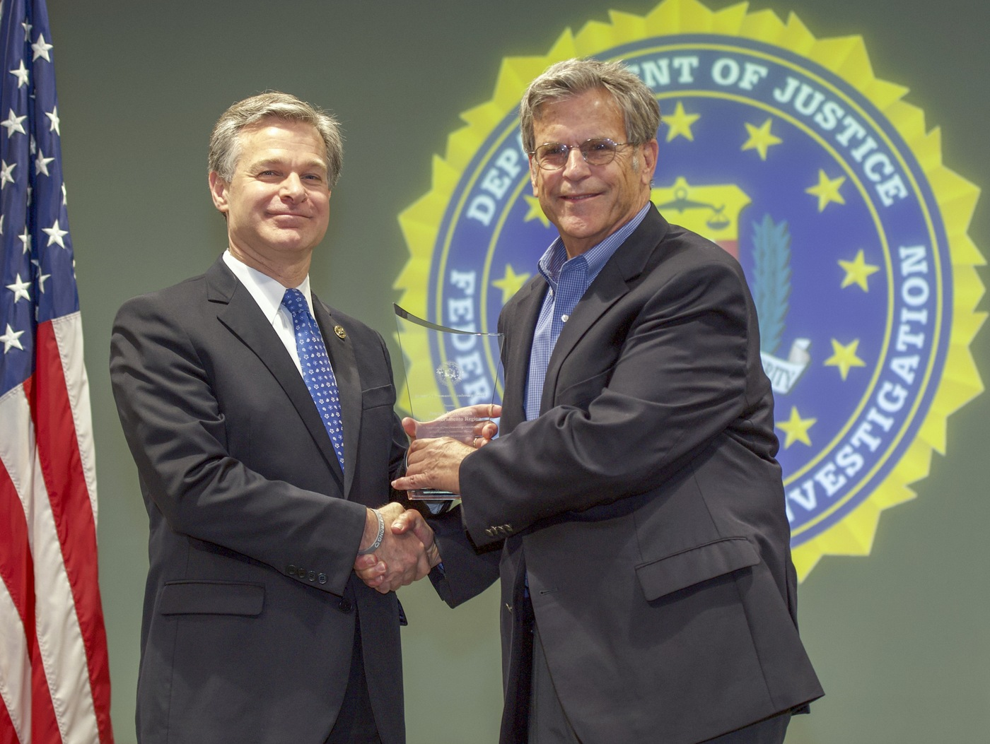 FBI Director Christopher Wray presents Sacramento Division recipient the Jewish Federation of the Sacramento Region (represented by Bruce Pomer) with the Director's Community Leadership Award (DCLA) at a ceremony at FBI Headquarters on May 3, 2019.