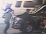 Two suspects responsible for robbing an armored vehicle courier at the Fashion Valley Mall at 7007 Friars Road in San Diego, California, on Friday, May 2, 2014.
