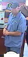 Suspect responsible for robbing the Bank of America branch located at 1350 East Valley Parkway in Escondido, California, on Monday, May 12, 2014.