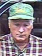 Bank robber nicknamed the Satchel Bandit who robbed two banks in California on separate days in August 2013. The suspect here is robbing the Union Bank located at 303 West Grand Avenue in Escondido, California on August 23, 2013.