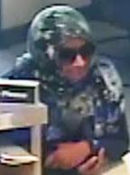 Suspect responsible for robbing the Comerica Bank branch located at 3361 Rosecrans Street, Suite 9A in San Diego, California, on Monday, July 14, 2014.