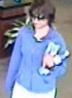 The Bombshell Bandit is believed to be responsible for robbing three bank banks, in three different cities, from June 6, 2014 to July 14, 2014. Here, she is shown robbing the Bank of the West, 27011 McBean Parkway, Valencia, California, on Thursday, July 3, 2014.