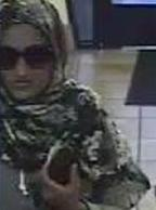 The Bombshell Bandit is believed to be responsible for robbing three bank banks, in three different cities, from June 6, 2014 to July 14, 2014. Here, she is shown robbing the Wells Fargo Bank, 1601 North Mc Culloch, Lake Havasu, Arizona, on Tuesday, July 8, 2014.