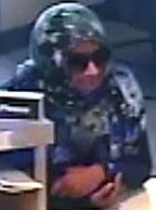 The Bombshell Bandit is believed to be responsible for robbing three bank banks, in three different cities, from June 6, 2014 to July 14, 2014. Here, she is shown robbing the Comerica Bank, 3361 Rosecrans Street, Suite 9A, San Diego, California, on Monday, July 14, 2014.