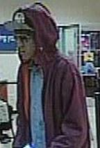 Suspect who robbed the U.S. Bank, located inside of the Vons grocery store 620 Dennery Road, San Diego, California, on Friday, August, 8, 2014.