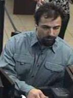 Suspect robbing the Chase Bank, located at 1641 South Melrose Drive, Vista, California, on Wednesday, October 15, 2014. The Bearded Bandit is also believed to be responsible for the October 7, 2014 bank robbery at the Wells Fargo Bank branch located at 685 Saturn Boulevard in San Diego, California.