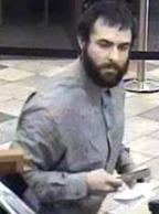 Suspect robbing the Wells Fargo Bank, 685 Saturn Boulevard, San Diego, California, on Tuesday, October 7, 2014. The Bearded Bandit is also responsible for robbing the Chase Bank branch located at 1641 South Melrose Drive in Vista, California, on Wednesday, October 15, 2014.